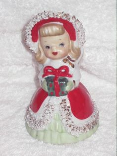 Vintage  Shopper Christmas Angel Girl Figurine BELL NAPCO Spaghetti Trim Candy Cane Wreath Decoration Ornament porcelain Japan. $35.00, via Etsy.