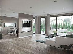 Musterhaus inneneinrichtung wohnzimmer  offener Wohnbereich mit moderner Einrichtung in neutralen Farben ...