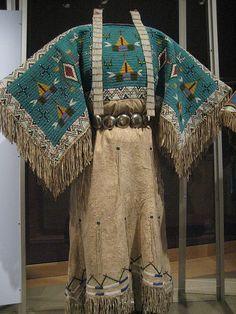 Yankton Dakota (Sioux) Two-Hide Pattern Dress w/ Fully Beaded Yoke -- Circa 1940, South Dakota -- Earrings, circa 1910, South Dakota.