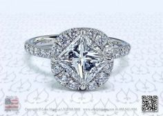 Princess cut diamond in a cushion halo set with micro pave by Leon Mege.