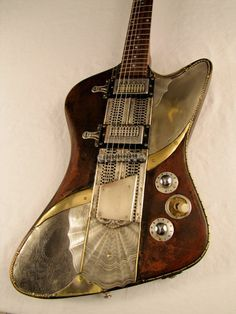 This one is a guitar. Love it. Antique-ish.