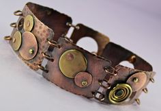 The patina on this came out even better than I expected. This cuff is all brass and copper circles on copper links.     OOAK Mixed Metal Linked Cuff Bracelet   by thirtyoneshekels, available on Etsy    #jewelry #handmade