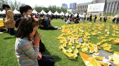 A girl prays in front of paper ships bearing messages for the victims of the sunken ferry Sewol at a group memorial altar in Seoul, South Korea. (AP/Ahn Young-joon) ▼5May2014ChannelNewsAsia|S Koreans mark sombre Children's Day in memory of ferry tragedy http://cna.asia/1jA5dcc #Sewol