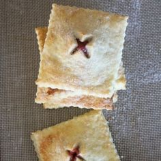 JUNE WK -  two lovely hand pies (both strawberry rhubarb, or one strawberry one rhubarb)   custard baked inside (or piped in after?)  **** basil or rosemary syrup drizzle ****cabernet balsalmic drizzle (two on plate, baked w/turbinado sugar, pastry cream smear on plate with herb syrup drops)