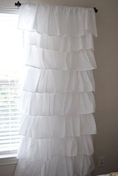 Ruffle curtains made from flat sheets for $8!  I may try this in the girls' rooms