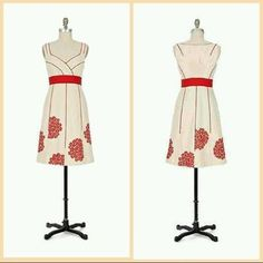 ANTHROPOLOGIE Floreat cream and red dress Beautiful textured cotton cream coloured dress with bunches of red embroidered flowers at the hemline.. And red piping throughout..side zipper..pockets.. In great condition. Anthropologie Dresses