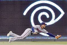Laying out:   Minnesota Twins left fielder Eddie Rosario misses an RBI triple by the Kansas City Royals' Salvador Perez in the eighth inning on Friday, April 8, at Kauffman Stadium in Kansas City, Mo.   -      © John Sleezer/Kansas City Star/TNS via Getty Images