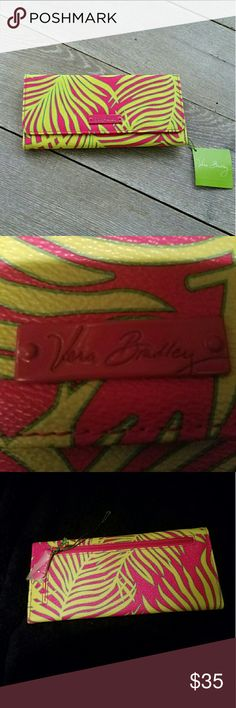 NWT Vera Bradley Wallet NWT Vera Bradley trifold wallet in hot pink and green palms design. Magnet locks. Lots of card holder spaces plus 2 ID slots, inside pocket for cash/checks and outside zipper pocket. This wallet is pretty!! Buy before I decide to keep it! Vera Bradley Bags Wallets