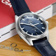 #Omega Constellation #Globemaster #watch. #METAS certified #antimagnetic to 15'000 gauss. Stainless steel case, 39mm diameter. Fluted bezel made of hard metal (tungsten carbide) to reduce damage due to wear. Metallic #blue pie-pan dial, index hour markers. Fitted with a blue alligator leather strap & a deployant buckle. OMega Calibre 8900 with #CoAxial escapement. Model number 130.33.39.21.03.001 MSRP $6900 visit www.prestigetime.com for pricing.