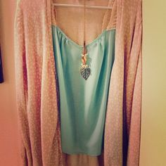 Adorable teal flowy top This is a reposh due to size. Beautiful teal flowy top, size medium. The back has a gorgeous detail. There are some small stains (they appear to be hair dye) as shown in photo. Easily covered with a sweater or kimono. Tops Tank Tops