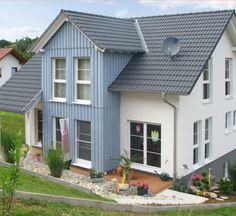 Familientraum in blau | zukunftssichere und energiesparende Bauweise | Haus Gneiting | WEISS Holzhaus