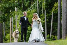 Erlowest wedding- the bride and groom walk with their dog during wedding photos.