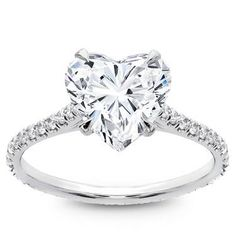 This mesmerizing vine moissanite ring will capture her heart from the moment she beholds it. Featuring a band adorned with gorgeous leaf and vine accents, it holds a brilliant forever brilliant moissanite center stone to finish off the design. Lady Gaga Engagement Ring, Disney Engagement Rings, Heart Shaped Engagement Rings, Engagement Rings Cushion, Modern Engagement Rings, Princess Cut Engagement Rings, Alternative Engagement Rings, Heart Shaped Diamond Ring, Heart Shaped Rings