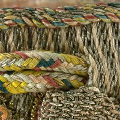 Detail of draw cord. Magnification 10x. Image by Cristina Balloffet Carr. early 17th century, British. Canvas worked with silk and metal thread, glass beads, spangles; Gobelin, tent, and detached buttonhole stitches; silk cord and silk and metal thread tassels. 5 1/8 x 5 1/8 in. (13 x 13 cm), excluding tassels and draw cord. Rogers Fund, by exchange, 1929 (29.23.15)