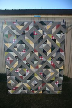 Half square triangle man quilt by lamb & george, via Flickr