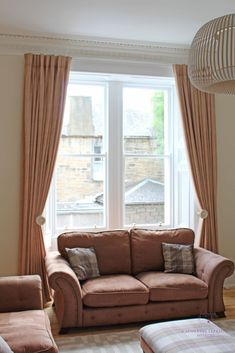 Ideas for decorating tall windows in a room with high ceilings.  Hang full length curtains drapes just below the cornice.