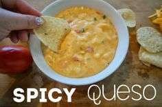 homemade spicy queso - melty cheese mixed into a basic bechamel with tomatoes, onions, and jalapenos