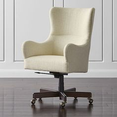 Smooth curves and cozy upholstery bring armchair style to our elegant Liv upholstered office chair. Covered in a nubby, oatmeal-colored basketweave, this smartly tailored yet comfortable upholstered chair moves about the room on a five-star base of tobacco brown-stained solid oak with antique brass casters.