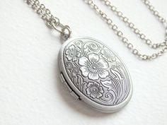 Hey, I found this really awesome Etsy listing at https://www.etsy.com/listing/177697600/sale-vintage-locket-long-silver-necklace