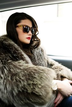 coat + shades + red lip.