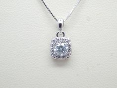 April birthstone diamond halo pendant. #scottandco At Scott & Co. Fine Jewelers we specialize in custom design jewelry serving but not limited to the following areas: Gettysburg, Hanover, New Oxford York, Lancaster, Carlisle, Chambersburg, Harrisburg (all of South Central) PA and Northern MD.  Visit us at the square in New Oxford, at 2 Lincoln Way E, New Oxford, PA 17350 or call us at (717) 624-1444.   http://scottandcofinejewelers.com