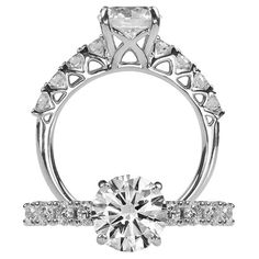 Classic diamond engagement ring featuring a prong set round cut diamond centerstone with four shared prong round cut diamonds on each side of the centerstone.