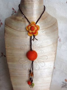 Felt and braided leather cord necklace with gold plated charms.