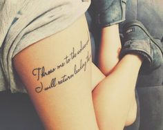 "Thigh tattoo saying ""Throw me to the wolves and I will return leading the pack"" on Despoina."