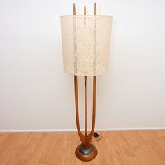 I have the table top version of this.  Danish modern floor lamp.