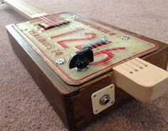 US number plate Cigar Box Guitar manufactured by Ian McDonald @ http://www.justplaytheblues.co.uk/