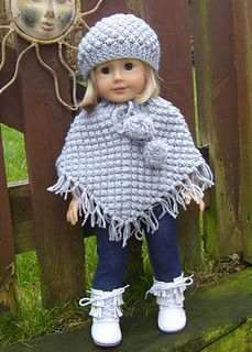 """Ravelry:  American Girl Doll Blackberry Poncho Set by Jacqueline Gibb (For 18"""" American Girl Doll & Bitty Baby.  - Written Instructions for a Blackberry Stitch Poncho with pom pom ties & a fringe & a Matching Hat.)"""