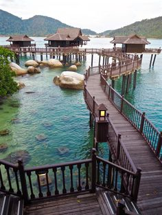The water was so clear she could see the strange and wonderful sea creatures floating beneath. Warm smells wafted from the stilted homes.