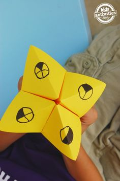Learning fractions with a paper game. Easy to make and fun for kids.