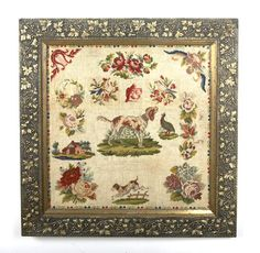 A framed needlepoint sampler