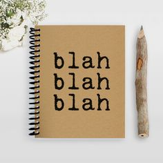 """This little spiral notebook features the message: """"Blah Blah Blah"""". We all have those days where we just feel """"blah"""" about everything! All of our notebooks are hand cut and assembled from only 100% po"""