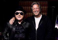 Van Morrison and friend Eric Clapton pose backstage during two sold out nights at London's Royal Albert Hall April 18, 2009 in London, England.
