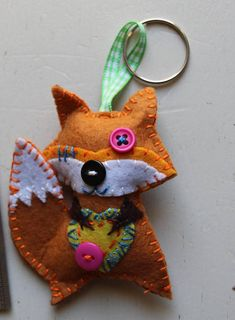 Fox is a felt created design to be used as a key chain or as a collectable item. All of my creations are unique and colourful. They are all handmade, with the help of my mother. Its size is about 7 cm (2.75 ). They are not suitable for children under 3 years of age, due to small parts.