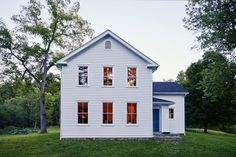 """The turn-of-century house received new siding and windows (made by Marvin), plus a 20-foot addition. By the time Dunja came along, the interior had undergone many incarnations and been stripped of original details: """"We had to go down to the studs; the project was like building a new house, but trying to imagine what the original builders had in mind."""""""