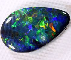 QUALITY BLACK SOLID STONE L RIDGE  1.20   CTS  INV-86 (R)  SOLID BLACK OPAL, MULTI COLOR AUSTRALIAN OPAL GEMSTONE,OPAL FROM AUSTRALIA