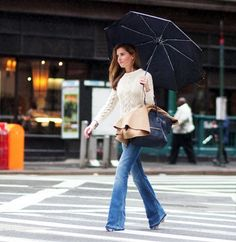 Rainy day style // Marina Larroude in a cable knit sweater, flared jeans, camel coat & Celine bag #style #fashion #streetstyle
