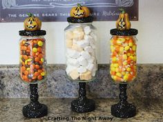 DIY Halloween Candy Jars made from mason jars and wooden candle holders, and painted with glitter paint.