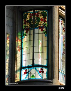 stained glass window on a tribune of a façade Art Nouveau style, in a building on Rambla de Catalunya in Barcelona.