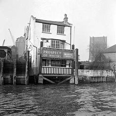 * An exterior view from the River Thames. The public house was originally built in 1520 and known as the Devil's Tavern through its association with thieves and smugglers. Its name was changed to the Prospect of Whitby in 1777.
