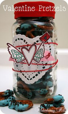 A great idea for Valentine gifts.  Perfect for teachers and for the hubby who loves choc covered pretzels