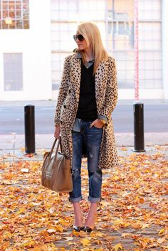 Leopard coat, cuffed jeans, and heels.