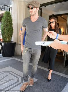 Smart, and casual: The former football looked relaxed in a grey T-Shirt and jeans, while t...