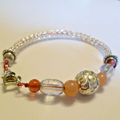 Ladies Viking knit bracelet: silver, pink, silver and clear beads. $26.00, via Etsy.