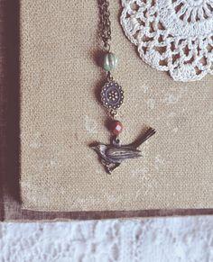 earthy beaded bird necklace.