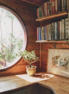 Small home library with round window and sunshine!