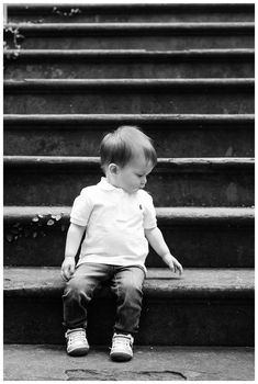 Little boy sitting on steps of Alex Raskins antiques. Downtown Savannah Georgia family photos photographed by Kristen M. Brown of Samba to the Sea Photography. #savannah #savannahga #familyphotos